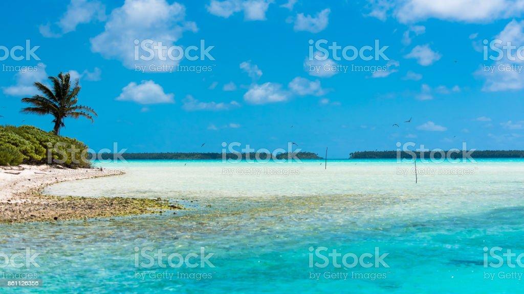 Desert island, motu, in French Polynesia stock photo