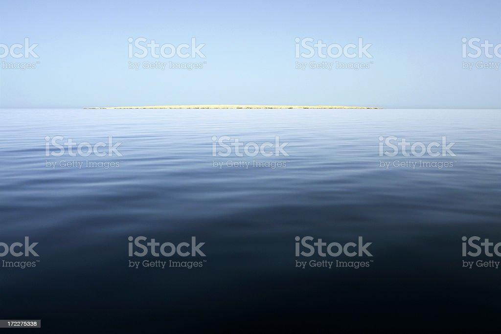Desert Island on Open Sea royalty-free stock photo