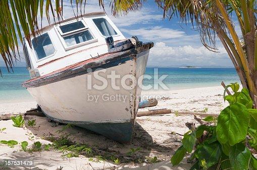 An old, abandoned boat on Bounty Island's beach, Fiji.
