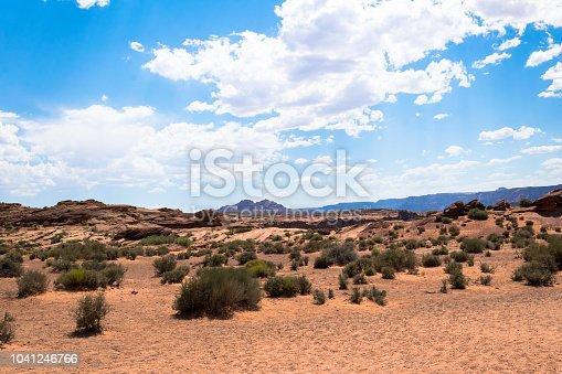 istock Desert landscape of Utah, USA. Weathered rocks, clear blue sky and desert bushes 1041246766