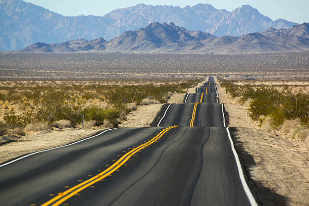 desert landscape with bumpy road - bumpy stock pictures, royalty-free photos & images