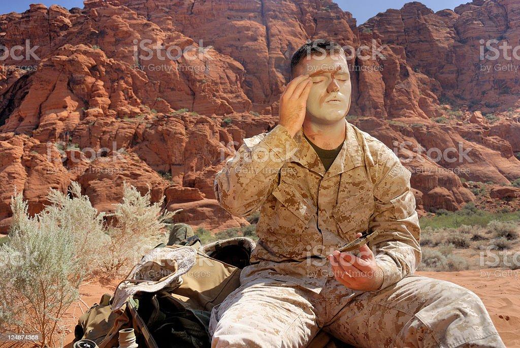 Desert Marine Preparing To Apply Camouflage Paint royalty-free stock photo