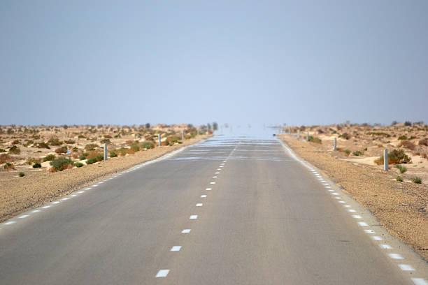 Desert mirage on road stock photo