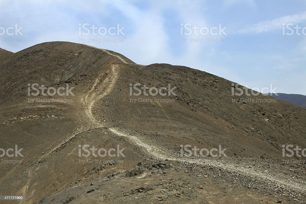 A pathway winding up a hill in the desert south of Lima, Peru