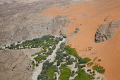 Aerial view of rock formation,dry riverbed and dunes in the Namib Desert