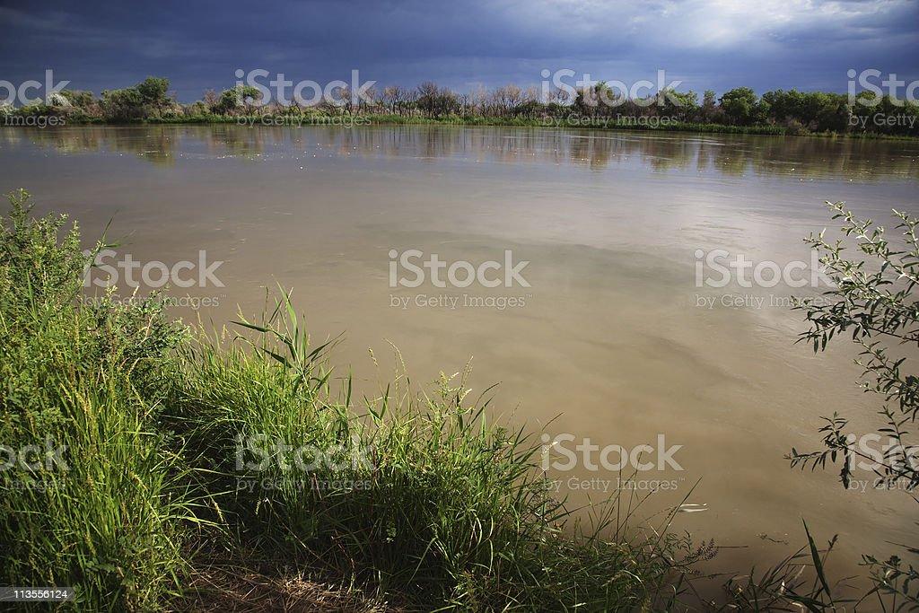 Desert river after storm stock photo