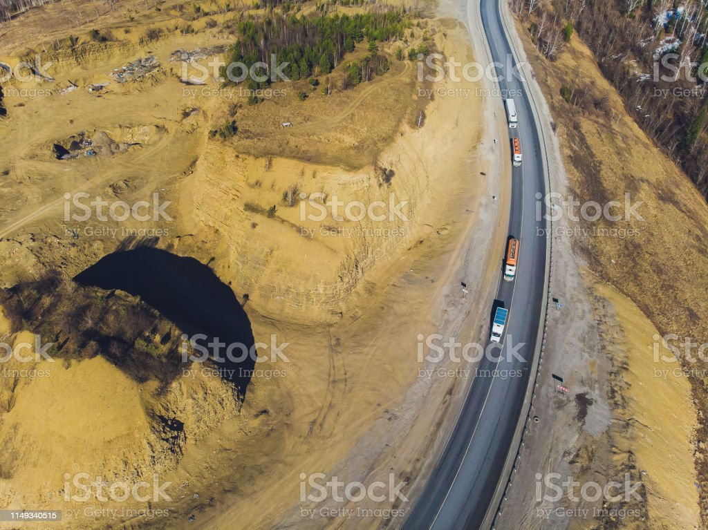 Desert road - Aerial image of traffic going up and down a serpentine...