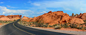 Desert road and red rocks