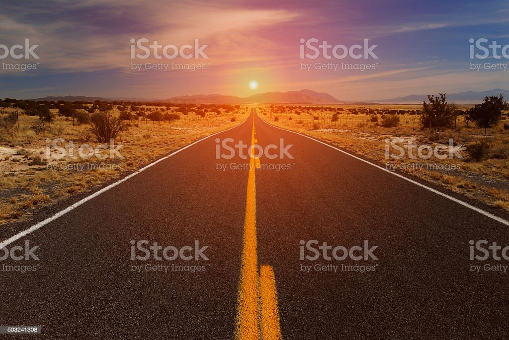 Desert Road and Sunset on Horizon stock photo