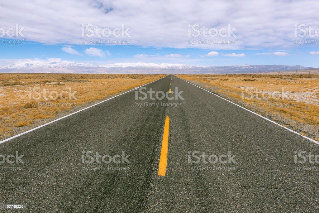 Desert Highway And Mountains through the Mojave Desert heading toward...