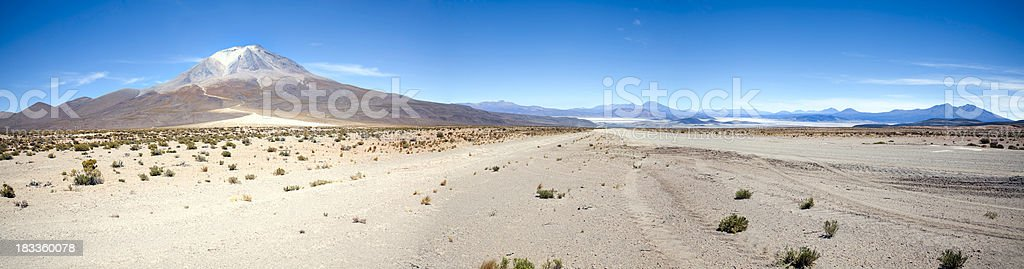 \'Dirt road in the desert south of Uyuni. Active Volcano, Ollague in...