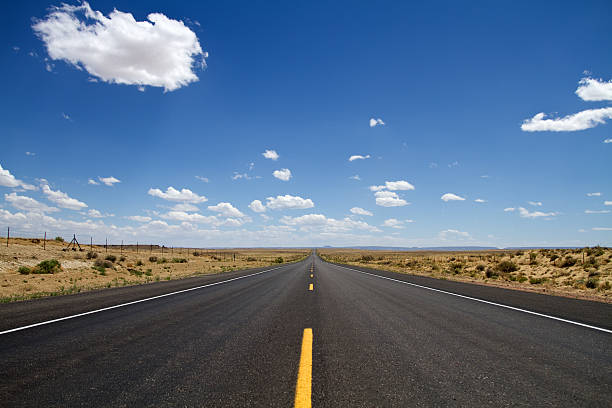 Desert road in New Mexico USA stock photo