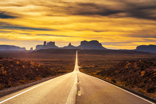 istock Desert road leading to Monument Valley at sunset 919792788