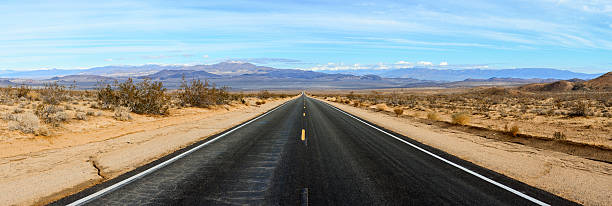 Desert Road Panorama Straight Road Panorama mojave desert stock pictures, royalty-free photos & images