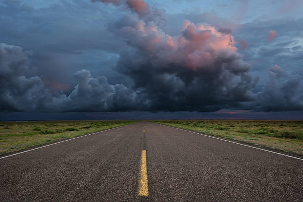 XXL desert road thunderstorm desert road with dramatic storm clouds (XXL) atmospheric mood stock pictures, royalty-free photos & images