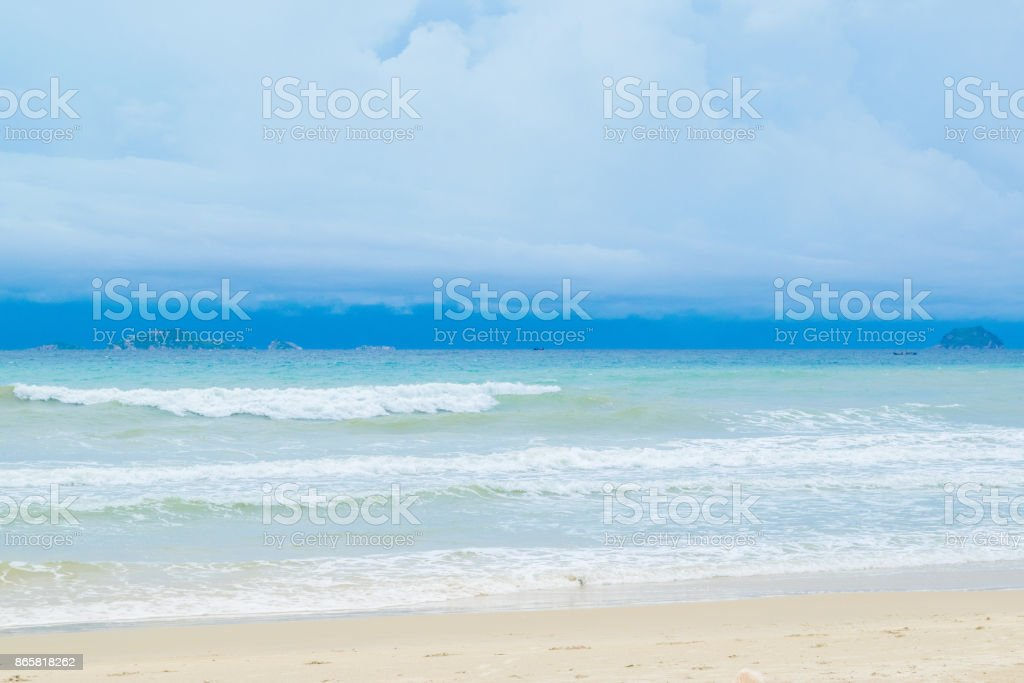 Desert sand beach with blue sky and waves, Vietnam, Nha trang, South China sea stock photo