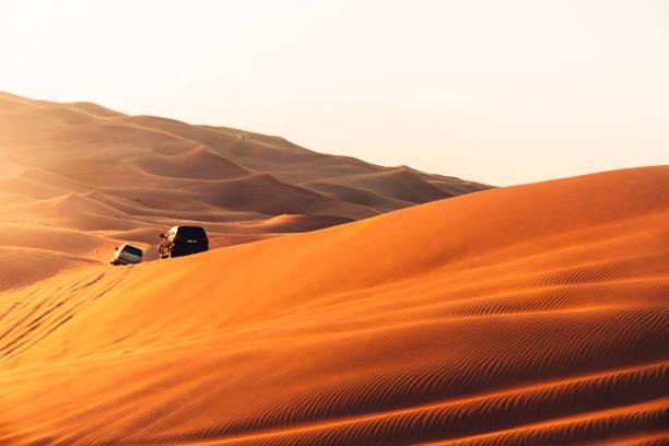 Desert sand dunes and safari experience at sunset stock photo