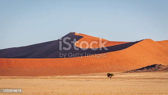 Warm late afternoon light close to sunset shining over the majestic Namibian Desert Sand Dunes at Sossusvlei, Sesriem, Namib-Naukluft National Park, Namibia, South West Africa.