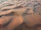Desert sand dunes at sunset