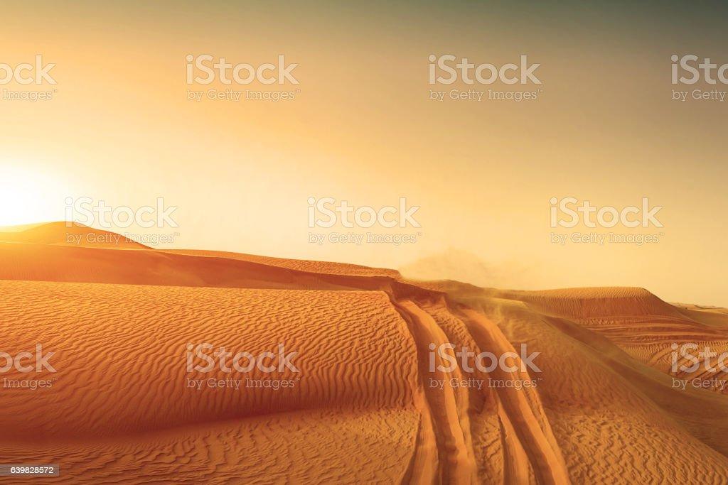 Desert sand dunes road at sunset royalty-free stock photo