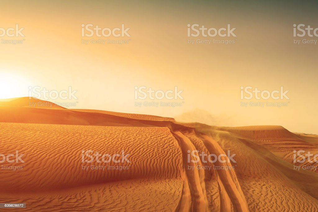 Desert sand dunes road at sunset ストックフォト