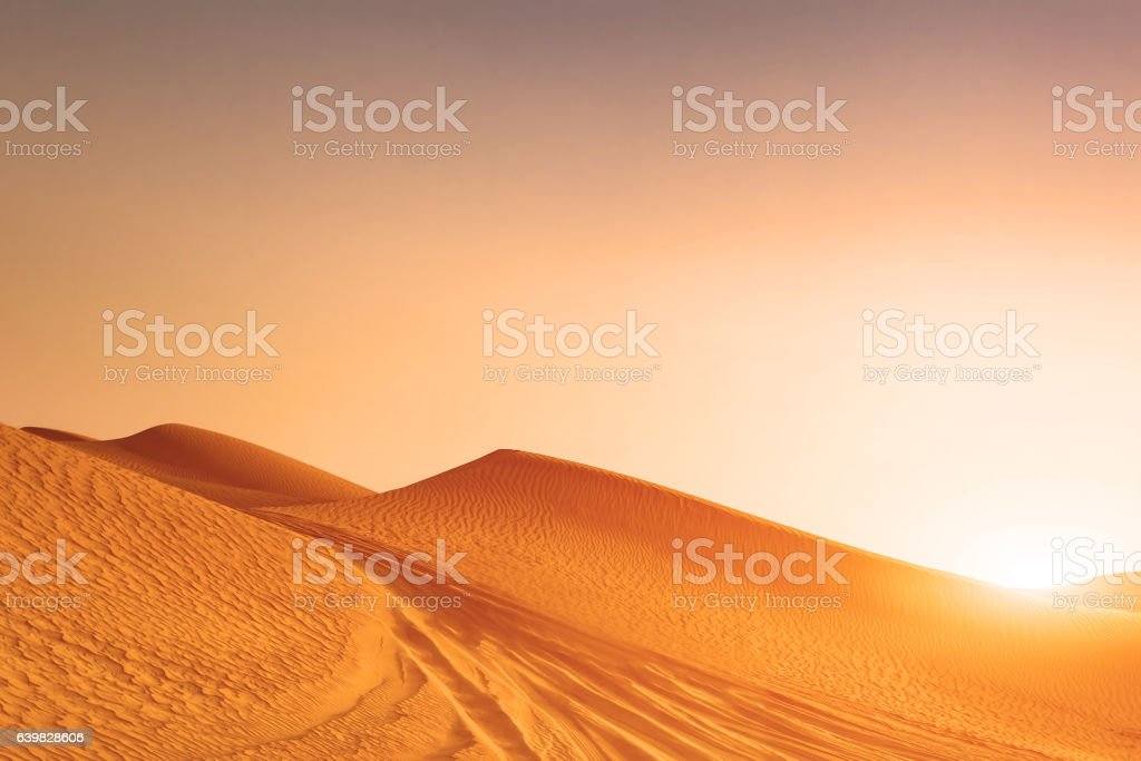 Desert sand dunes road at sunset stock photo
