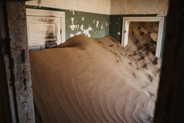 desert sand has invaded and taken over these rooms in Kolmanskoppe, Namibia stock photo