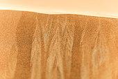 A macro view of slipping sand in the desert of Dubai, UAE