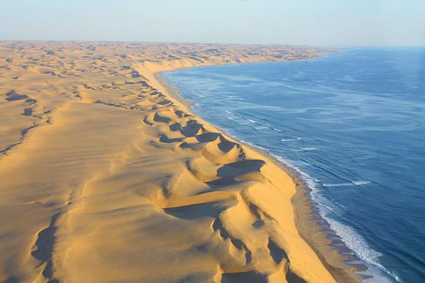 Desert Sanddunes Coastline Sanddunes of the Namib Desert meet the Coastline of the Ocean namib desert stock pictures, royalty-free photos & images