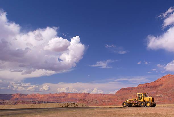 desert sandstone landscape construction grader sky stock photo