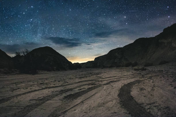 Desert Stars Stars over an arroyo in Anza Borrego Desert State Park, CA riverbed stock pictures, royalty-free photos & images