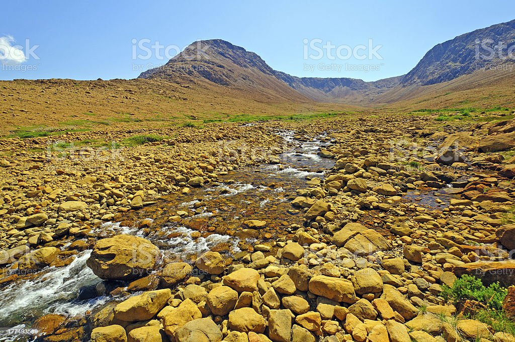 Desert Stream cutting through Volcanic Rock stock photo