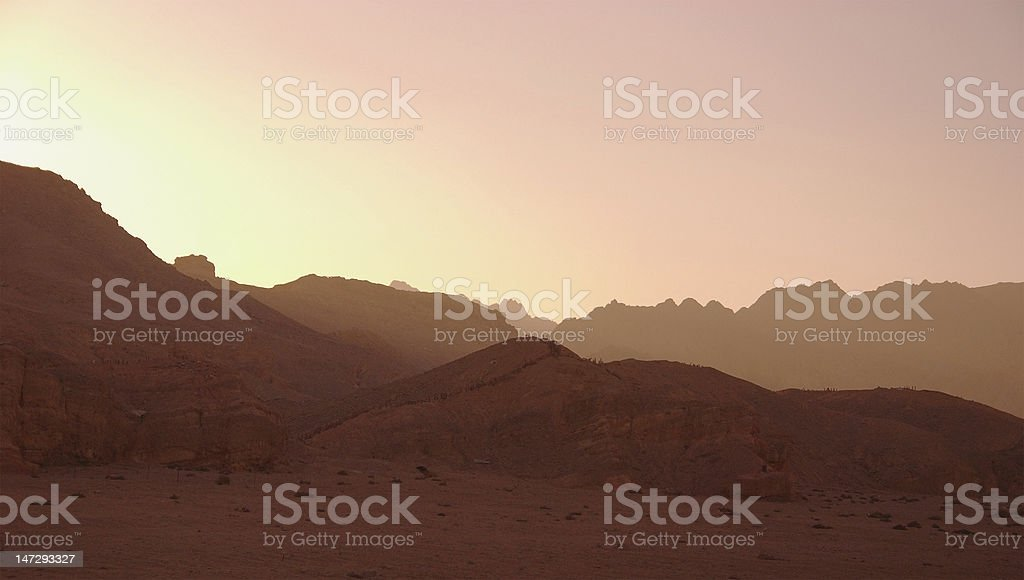 Desert sunset background - sunny sky and mountains stock photo