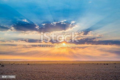 Dramatic Sunset over the desert with clouds blue sky and bright orange horizon Namibian Desert Namib Rand Namibia Africa