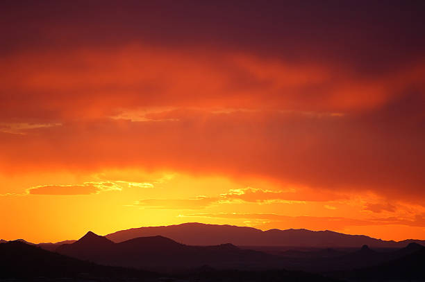 Desert sunset with bright color gradients stock photo