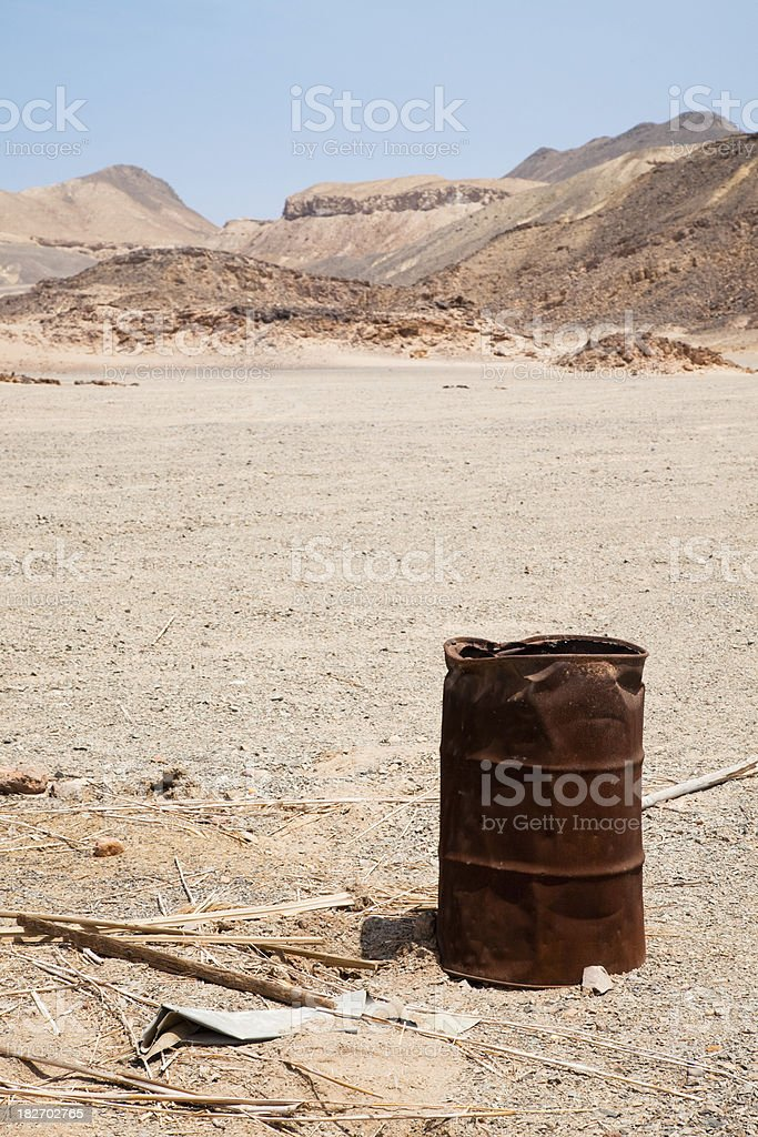 Desert track with oil barrel royalty-free stock photo