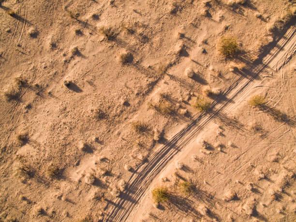 desert trail - aerial overview soil stock-fotos und bilder