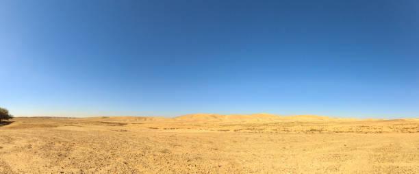 Desert under blue sky stock photo