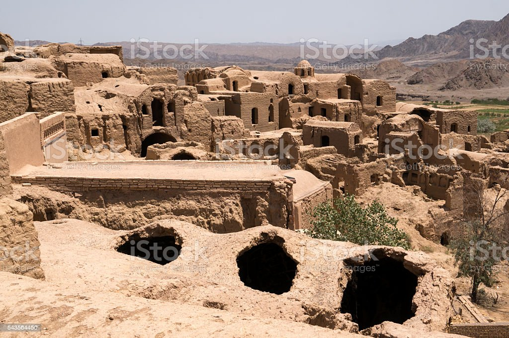 Deserted and crumbling mud-brick village of Kharanaq, Iran stock photo
