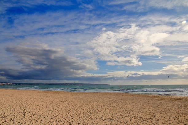 Deserted beach of the island of Palma de Mallorca in windy weather.