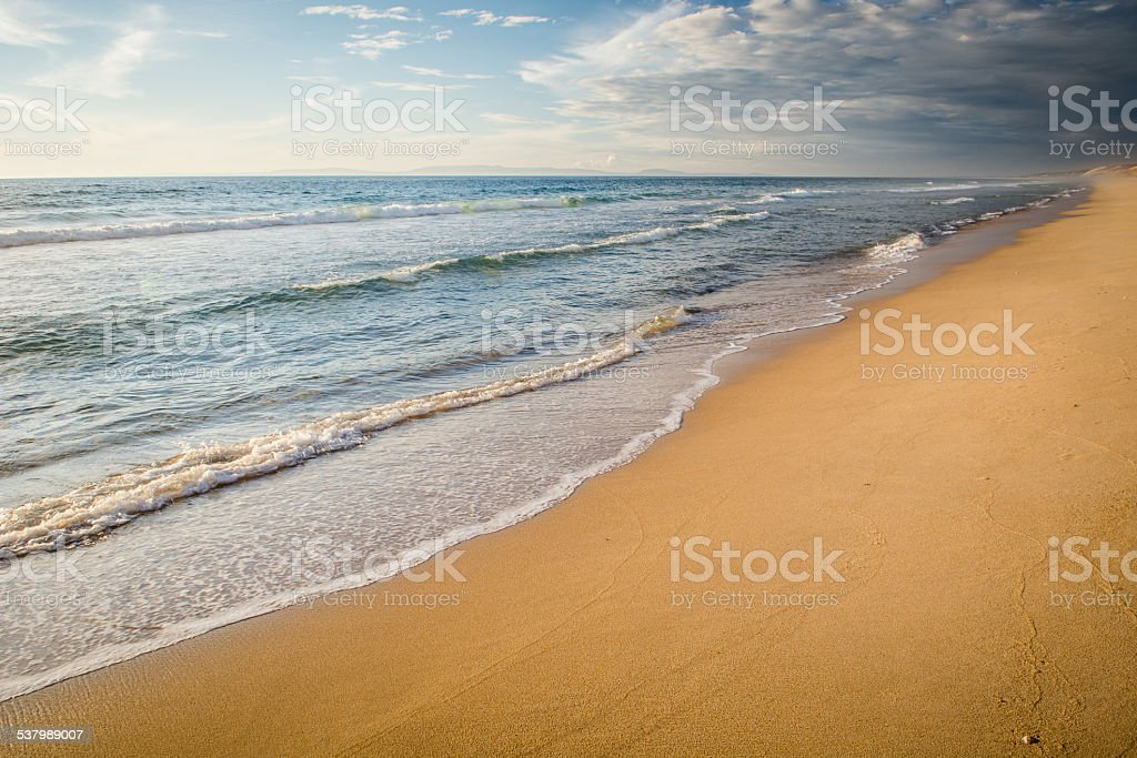 Deserted beach with waves without people stock photo