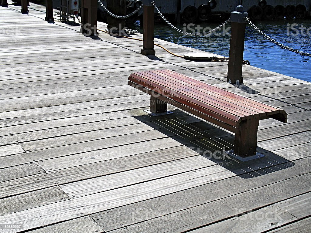 Deserted bench on pier. royalty free stockfoto
