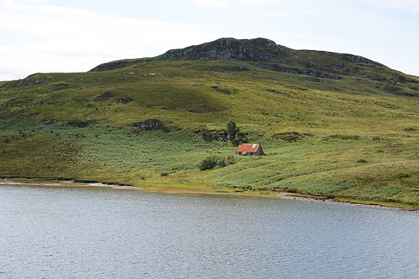 Deserted Bothy below Hill stock photo