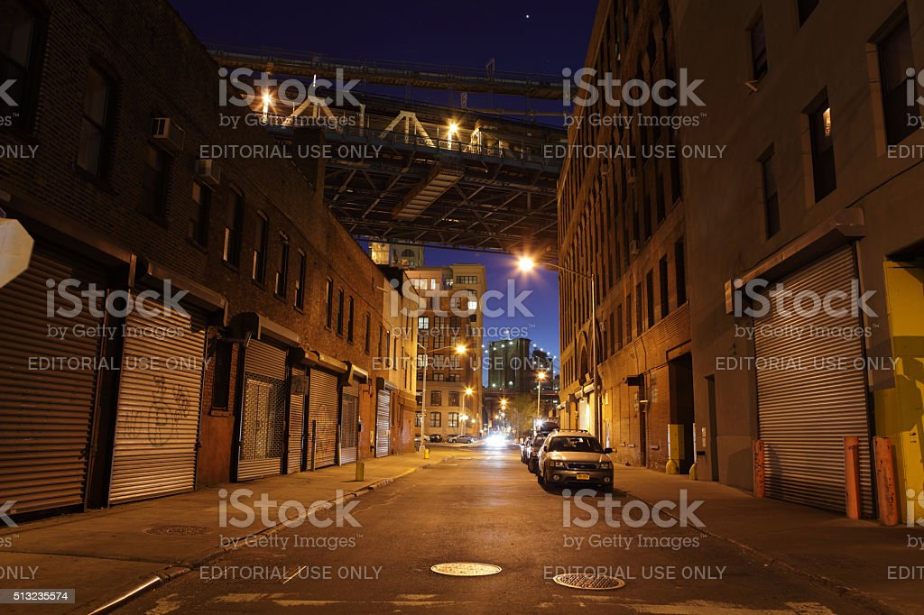 Deserted Brooklyn DUMBO back street under the bridges at night stock photo