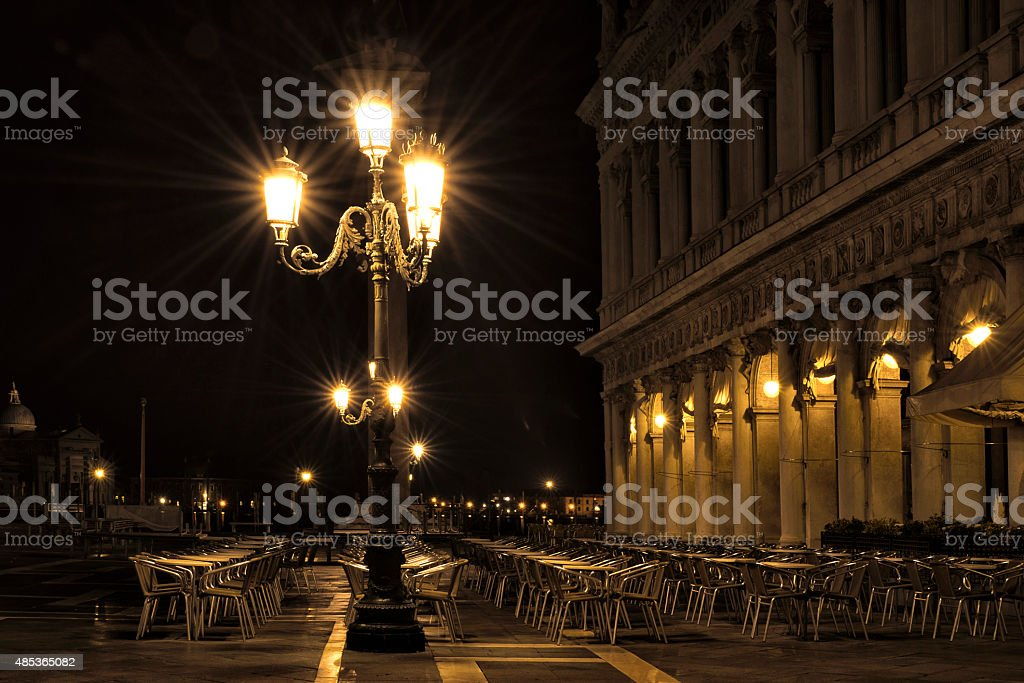 Deserted cafe in St Mark's Square at night royalty-free stock photo