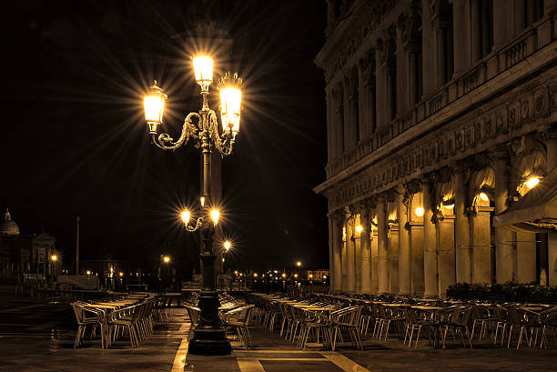 Deserted cafe in St Mark's Square at night stock photo