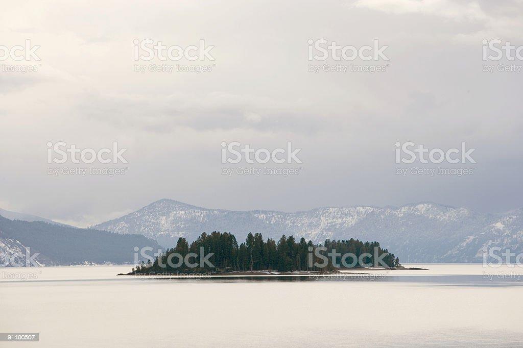 Deserted island in Lake Pend Oreille, Idaho. stock photo