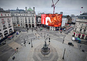 The empty but normally grid-locked Piccadilly Circus in the heart of London's West End, on a weekday lunchtime. Iconic London locations empty at the start of the Corona Virus pandemic