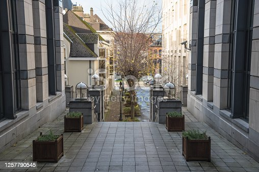 istock Deserted narrow alley between office buildings in a city centre 1257790545