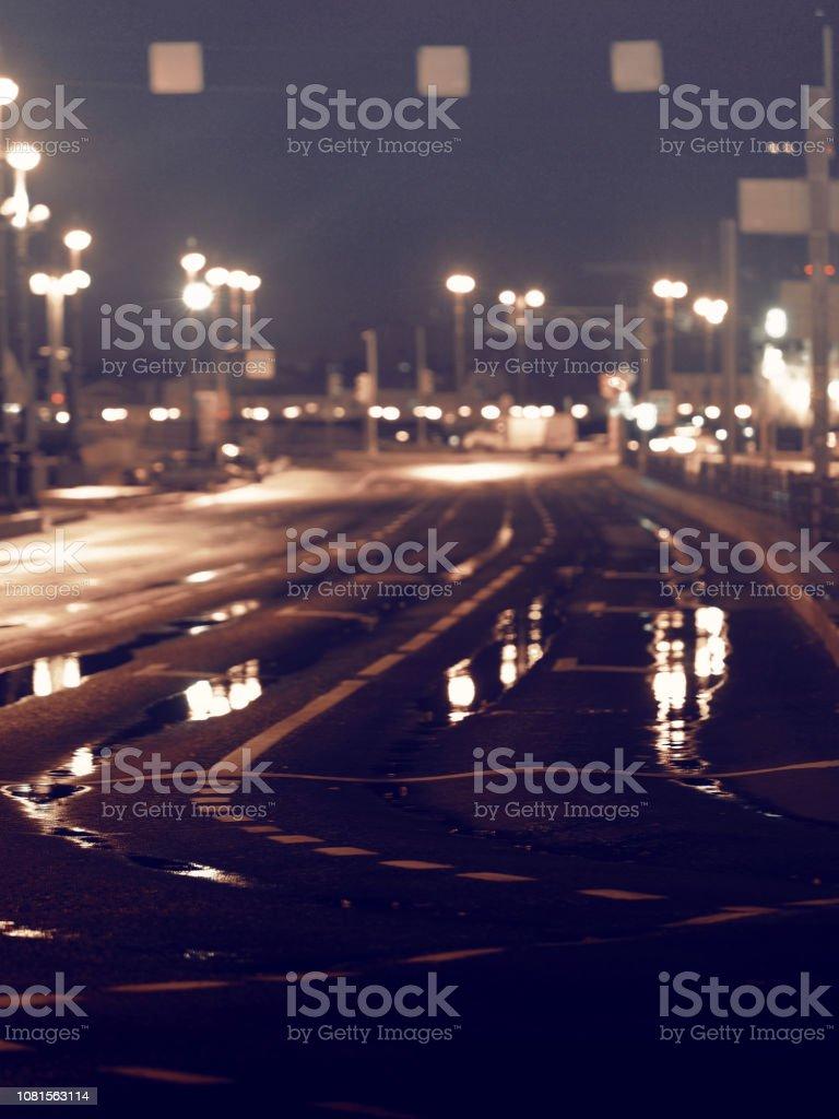 Deserted night city after the rain, nobody. Dark empty street. Toned...